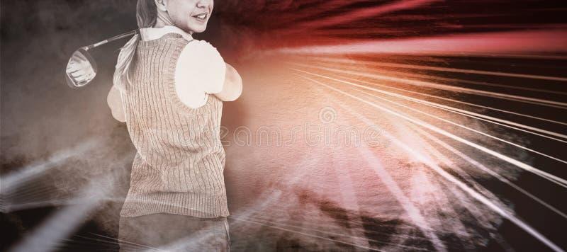 Imagem composta do golfe de jogo louro bonito fotos de stock royalty free