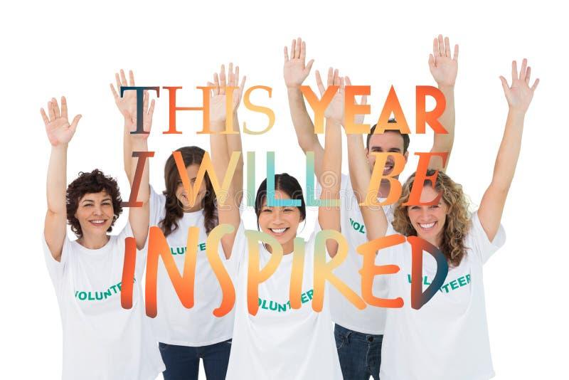 Imagem composta do grupo de voluntários que aumentam os braços fotos de stock royalty free