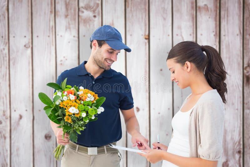 Imagem composta do homem de entrega feliz da flor com cliente imagem de stock