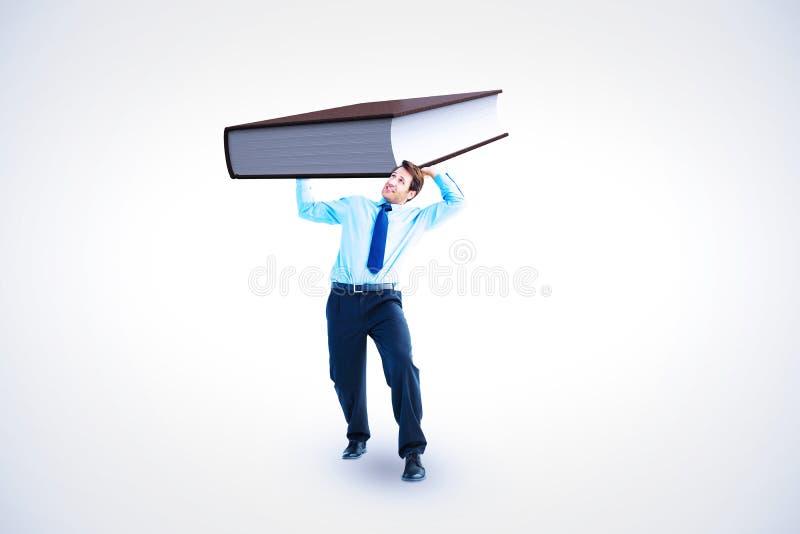 Imagem composta do homem de negócios focalizado que levanta acima de algo pesado imagens de stock