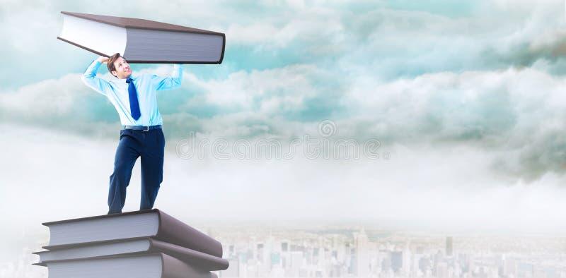 Imagem composta do homem de negócios focalizado que levanta acima de algo pesado fotos de stock
