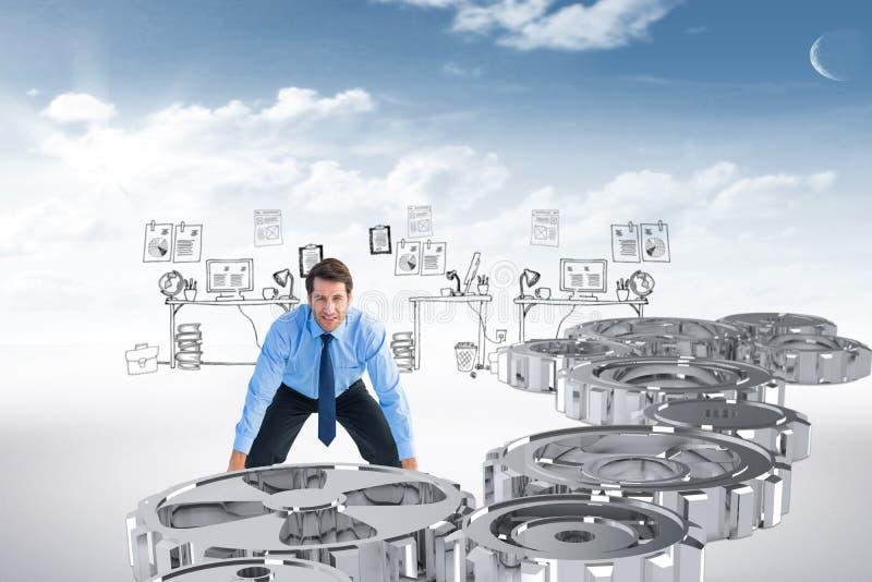 Imagem composta do homem de negócios focalizado que levanta acima de algo pesado imagem de stock