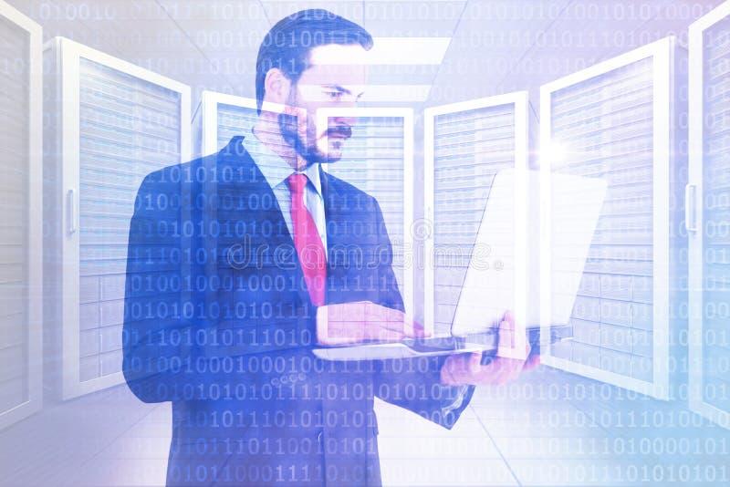 Imagem composta do homem de negócios focalizado que usa seu portátil ilustração stock