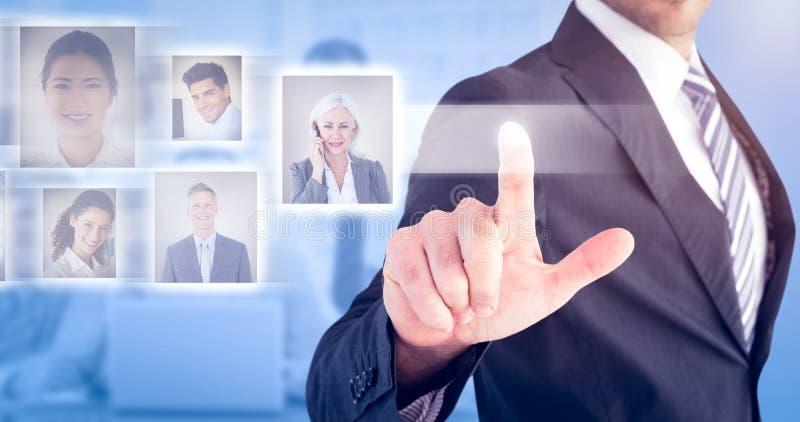Imagem composta do homem de negócios que aponta com seu dedo fotos de stock royalty free