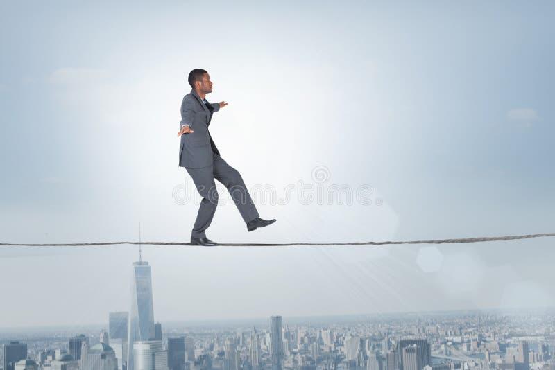 Imagem composta do homem de negócios que executa um exercicio de equilibrio imagem de stock royalty free