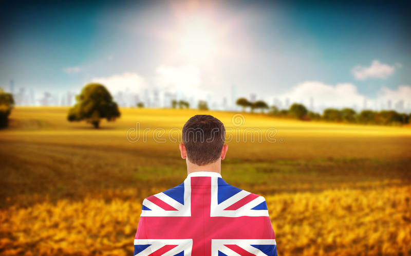 Imagem composta do homem de negócios que olha na frente dele no terno fotografia de stock royalty free