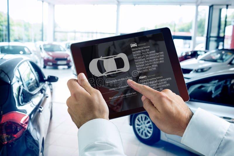Imagem composta do homem de negócios que usa a tabuleta digital ao lado do smartphone foto de stock