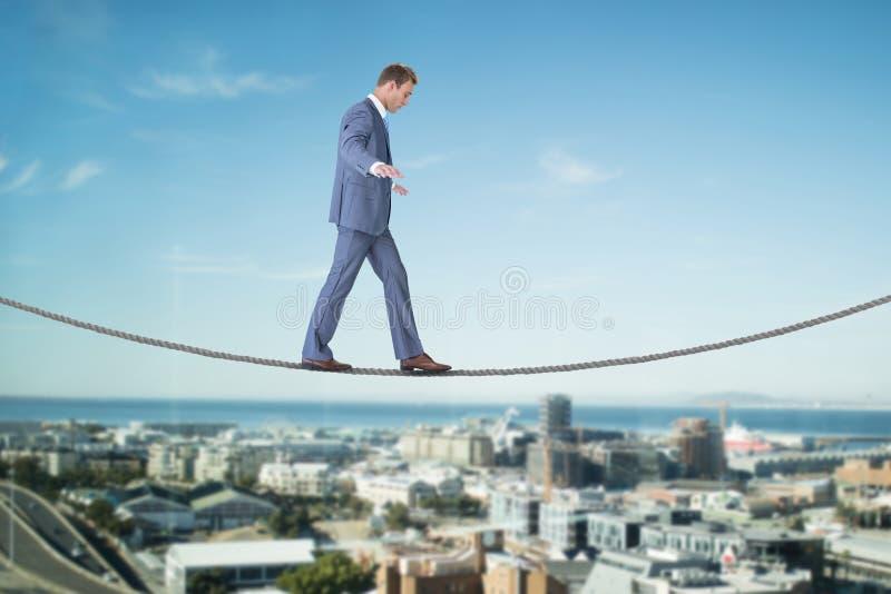Imagem composta do passeio do homem de negócios fotos de stock royalty free