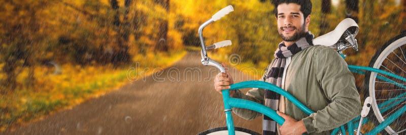 Imagem composta do retrato da bicicleta levando de sorriso do homem fotos de stock royalty free