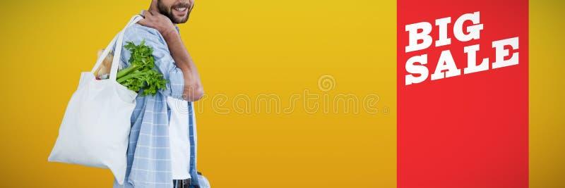 Imagem composta do retrato de vegetais levando do homem no saco de compras fotografia de stock