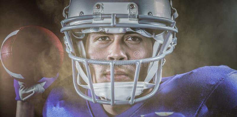 Imagem composta do retrato do close-up do desportista que guarda a bola fotografia de stock