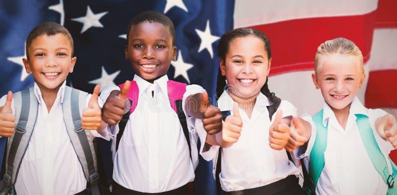A imagem composta do retrato dos estudantes que mostram os polegares levanta o sinal foto de stock royalty free