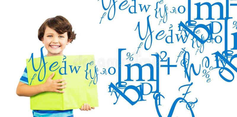 Imagem composta do retrato do menino de sorriso que guarda o Livro Verde fotografia de stock
