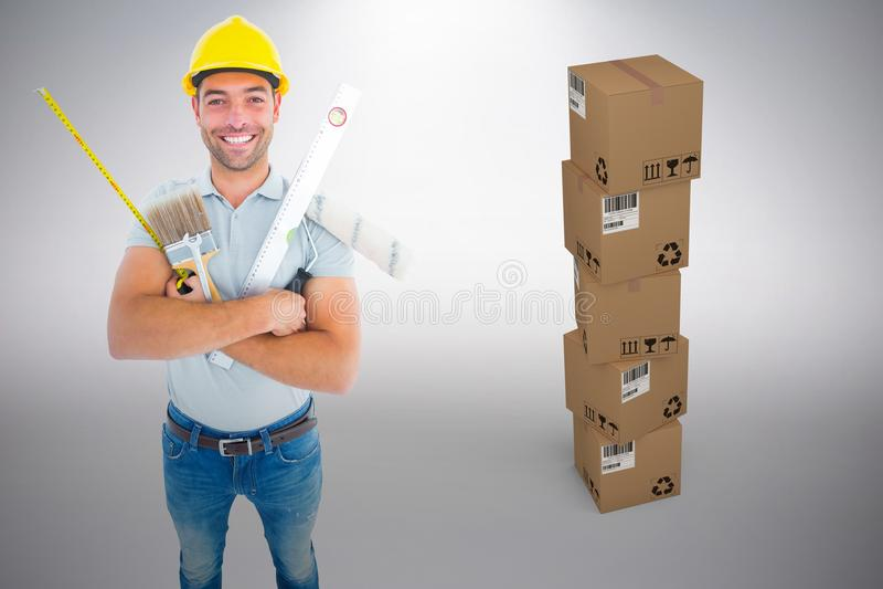 Imagem composta do retrato do trabalhador manual feliz que guarda várias ferramentas imagem de stock