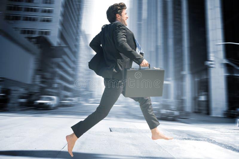 Imagem composta do salto do homem de negócios imagens de stock