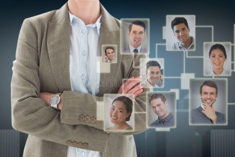 Imagem composta dos braços eretos da mulher de negócios feliz cruzados foto de stock royalty free