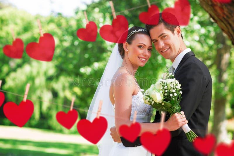 Imagem composta dos corações que penduram em uma linha fotografia de stock