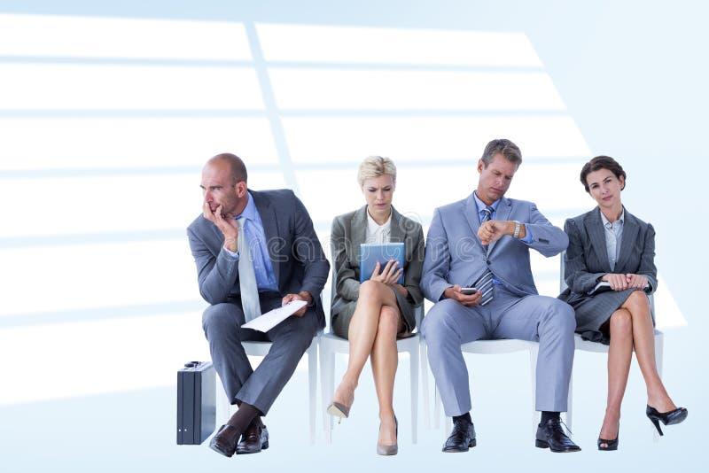 Imagem composta dos executivos que esperam para ser chamado na entrevista fotografia de stock