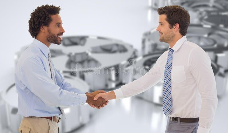 Imagem composta dos homens de negócios novos de sorriso que agitam as mãos no escritório imagens de stock royalty free
