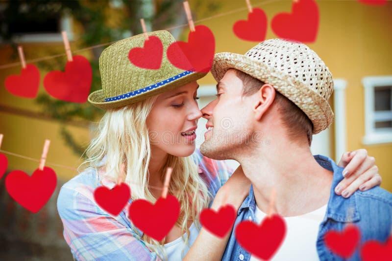 Imagem composta dos pares novos ancas aproximadamente a beijar ilustração stock