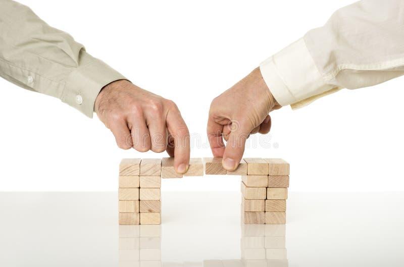 Imagem conceptual da fusão e da cooperação do negócio imagens de stock royalty free