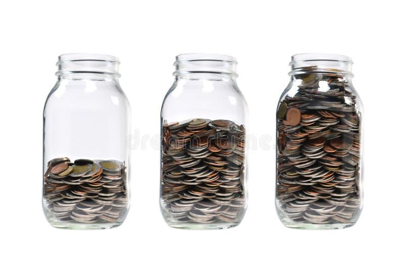 Imagem da etapa da pilha das moedas no frasco de vidro para o negócio imagens de stock royalty free