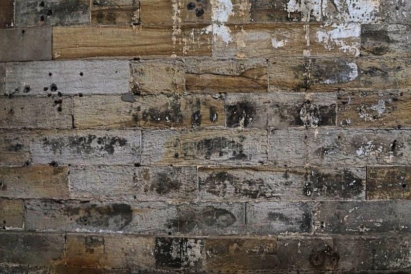 Imagem da grão do fundo da parede de pedra do tijolo em detalhe e do patte da textura imagem de stock