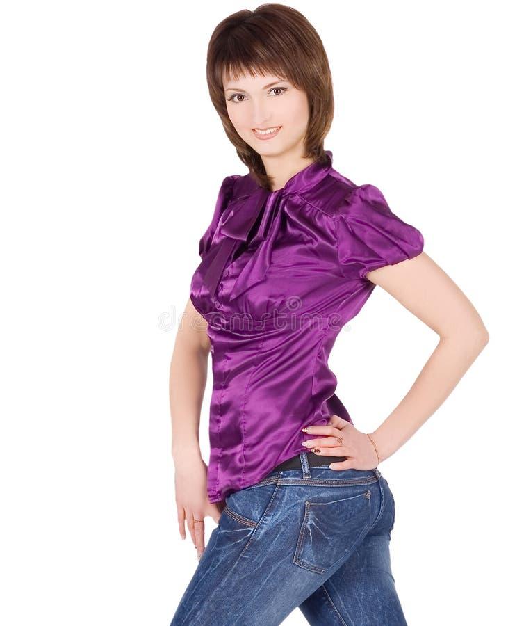 Imagem da jovem senhora que levanta sobre o fundo branco fotos de stock