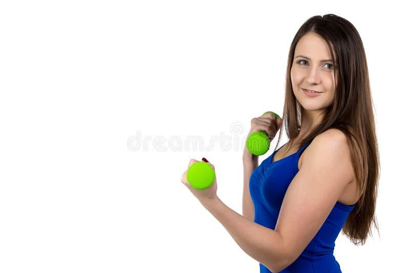 Imagem da mulher desportiva com pesos imagens de stock royalty free