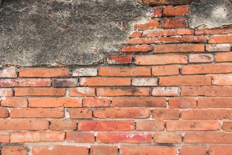 Imagem de fundo velha da textura da parede do tijolo e do cimento O vermelho do Grunge obstr?i o fundo fotografia de stock royalty free