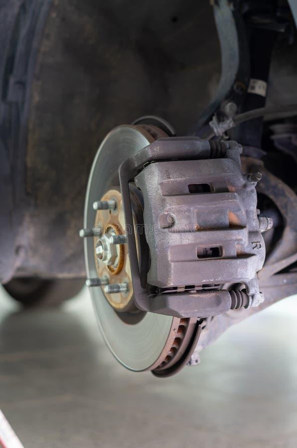 Imagem de um disco do freio e de seu compasso de calibre do freio fotografia de stock royalty free