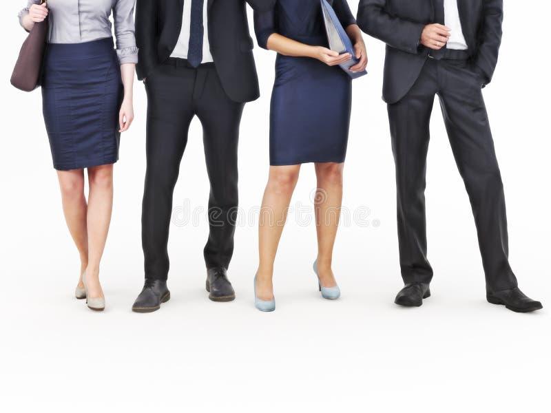 Imagem de um grupo de homens de negócios novos e de mulheres de negócios que estão em um fundo branco fotografia de stock royalty free