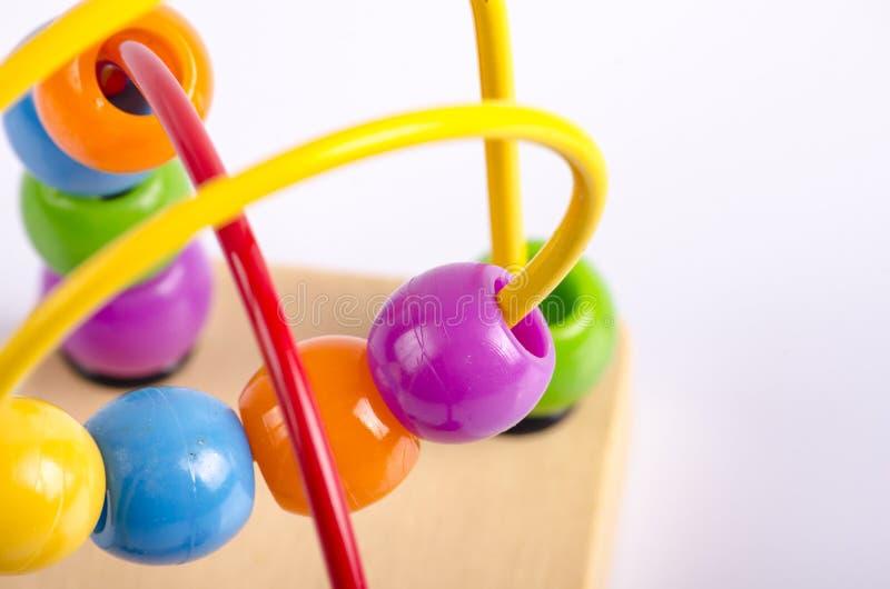 Imagem do close up do brinquedo da bola do coster do rolo dos grânulos no backgroun branco foto de stock