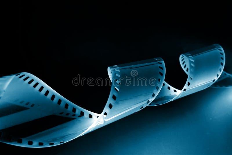 Imagem do Close-up de ondular a película de 35mm imagens de stock
