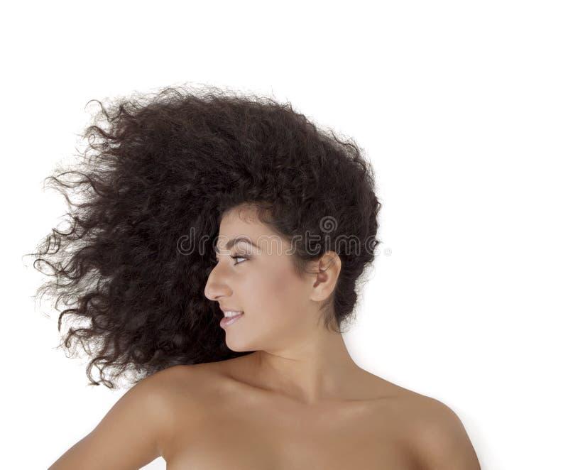 Imagem do close-up de um modelo de forma fêmea que olha sobre o ombro imagem de stock