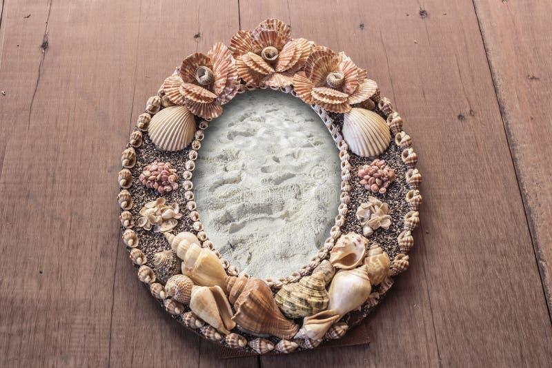 Imagem do quadro feita dos shell Areia da moldura para retrato imagens de stock royalty free