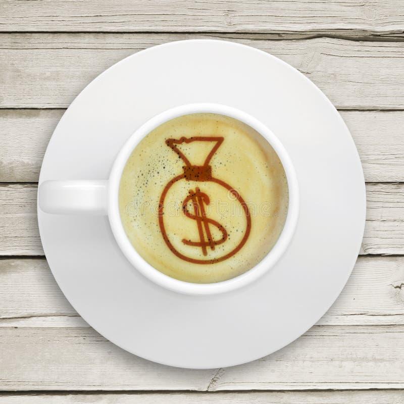Imagem do saco do dinheiro na espuma do café imagem de stock royalty free