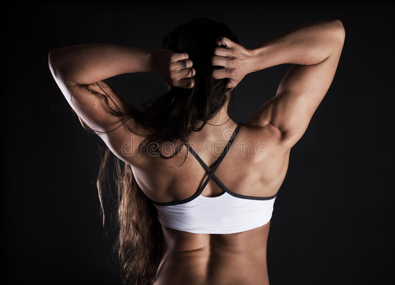 Imagem do sportswoman muscular 'sexy' imagem de stock