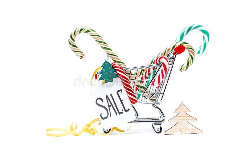 Imagem do trole com bastões do caramelo, árvore de Natal, cartão, fita imagem de stock