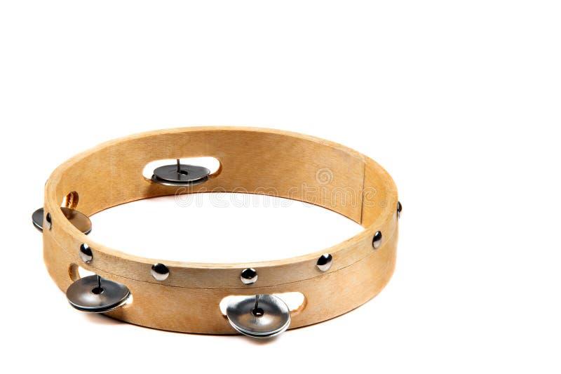 Imagem isolada do pandeiro de madeira com o sino no fundo branco fotos de stock royalty free