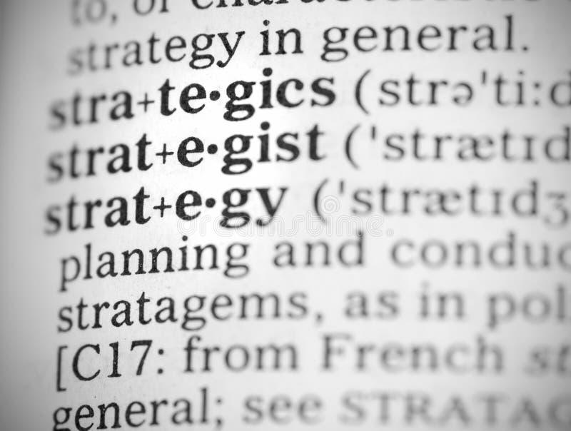 Imagem macro da definição de dicionário da estratégia imagens de stock