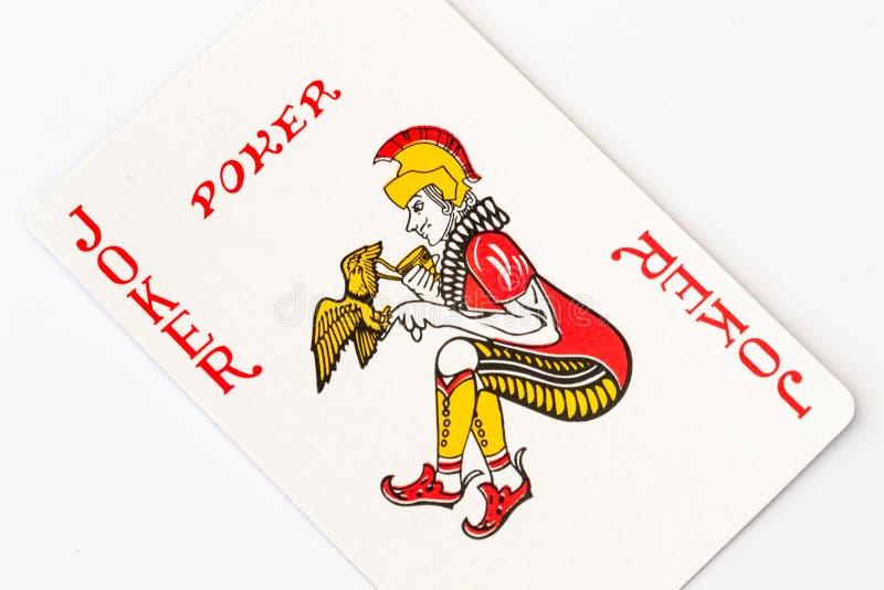 Imagem macro do estúdio de um cartão de jogo vermelho do palhaço imagens de stock royalty free