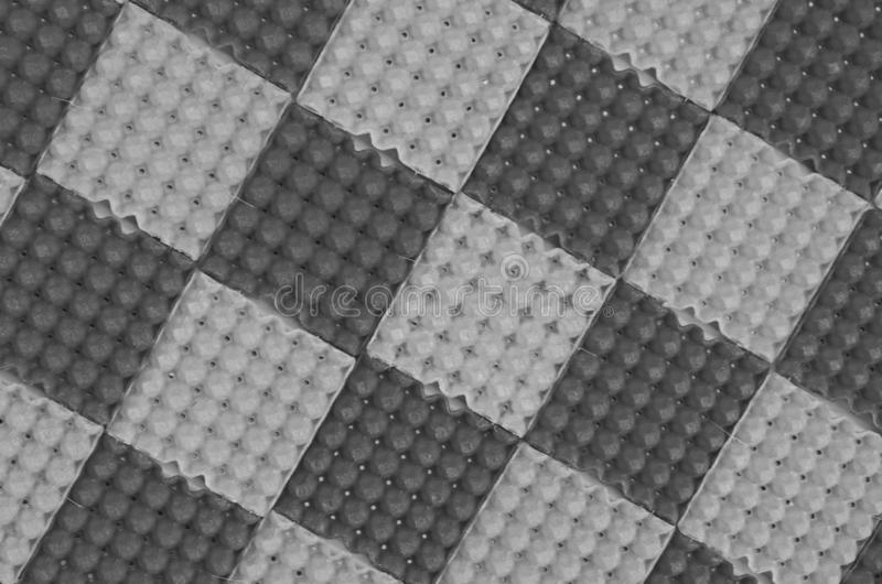 Imagem preto e branco do teste padrão da textura da placa da bandeja do ovo foto de stock royalty free