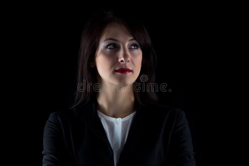 Imagem que olha a mulher de negócio moreno ausente imagem de stock royalty free