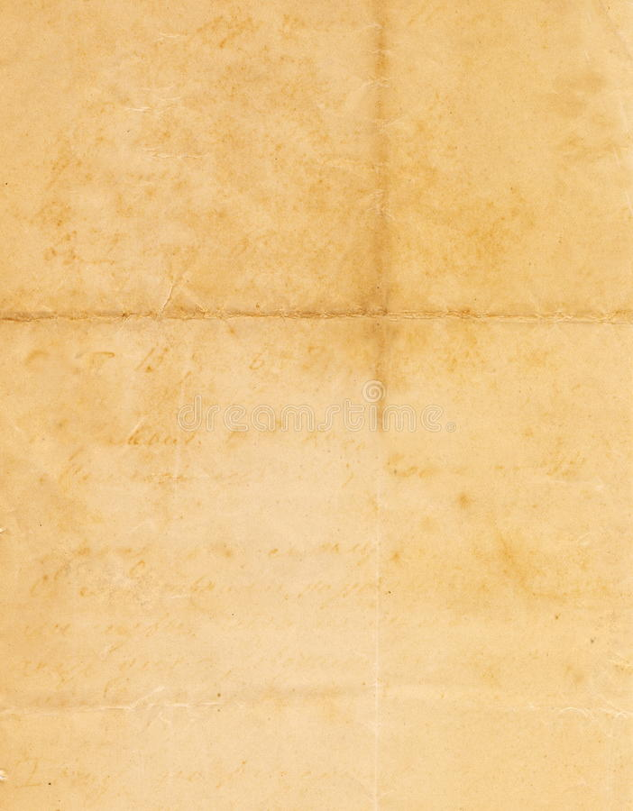 Imagem sem emenda fechado da folha de papel amarelada velha com pontos escuros e um fac-símile da inscrição fotos de stock royalty free
