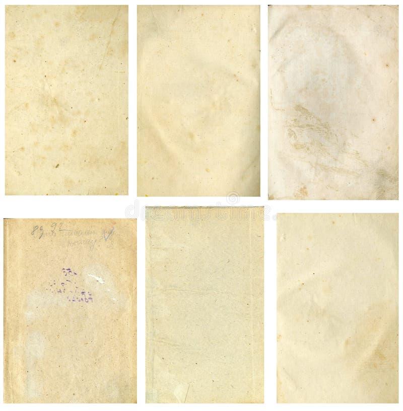 Imagem sem emenda fechado de uma folha do papel amarelado velho com os pontos marrons escuros, traços de tempo foto de stock