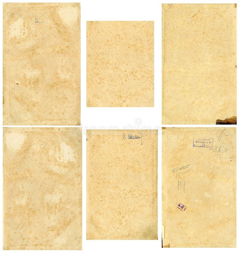Imagem sem emenda fechado de uma folha do papel amarelado velho com os pontos marrons escuros, traços de tempo imagens de stock