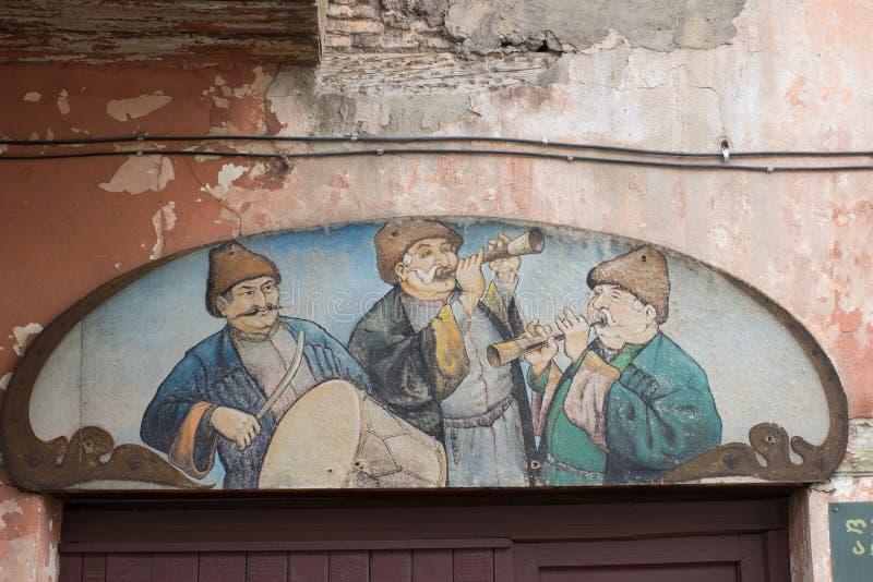 A imagem velha no sinal do restaurante no centro da cidade de Tbilisi, Geórgia imagem de stock royalty free