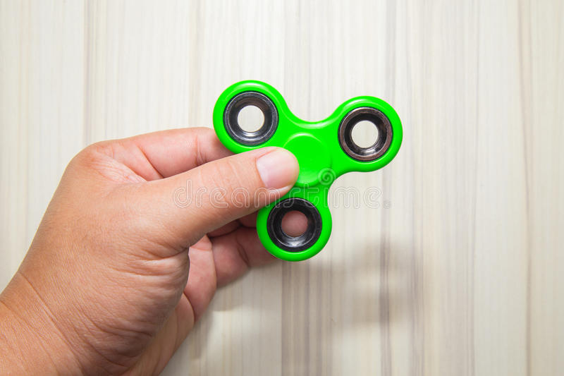 Imagem verde do brinquedo do girador do dedo da inquietação foto de stock royalty free