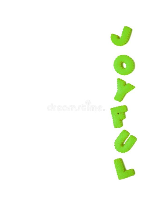 A imagem vertical da palavra ALEGRE soletrada com alfabeto colorido verde vívido deu forma a biscoitos no fundo branco fotos de stock